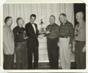 The trophy being presented in the 1950s.
